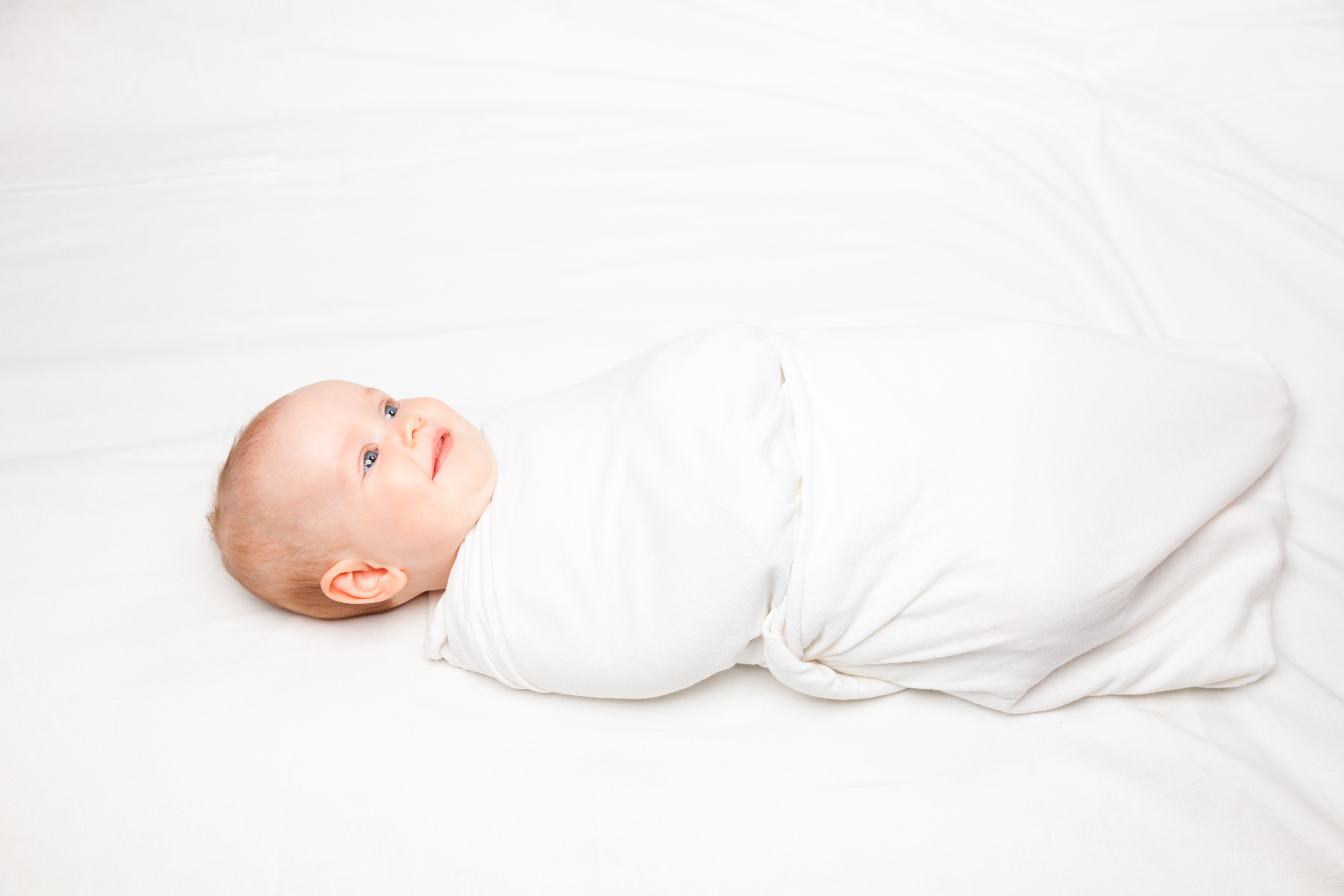 bigstock-Three-month-baby-girl-swaddled-103956806.jpg